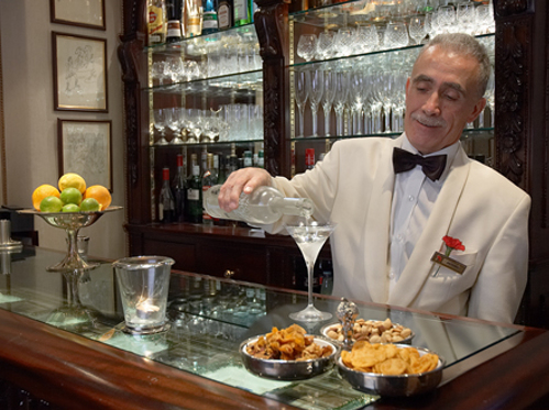 Antonio serving a Martini at The Egerton Hotel